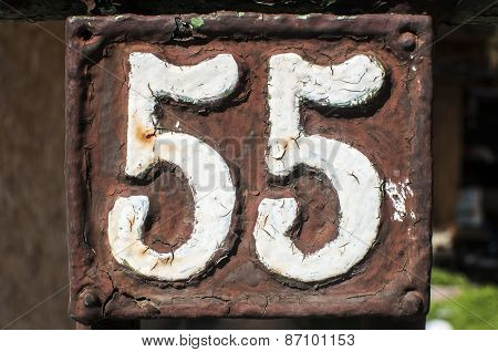 Old retro cast iron plate number 55