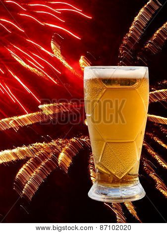 Beer Glass On Multicolored Fireworks Background.