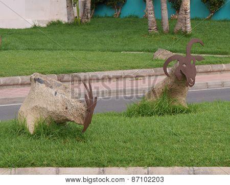 Decorative goats along a street