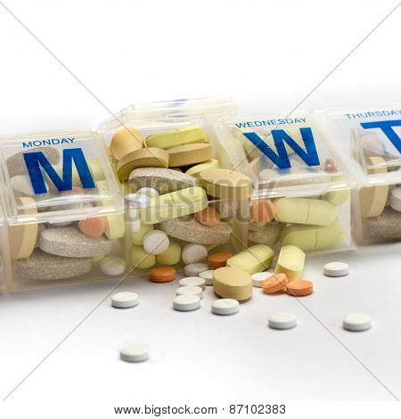 Pills Spill Out Of A Dossette Box