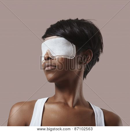 Woman With An Eye Mask, Making An Eye Treatment And Lines Spread From Mask