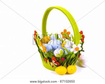 Isolated Easter basket with artificial eggs