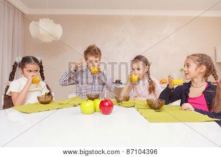 Kids drinking juice together