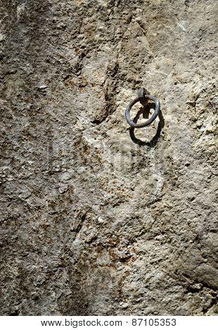 Climbing Iron Ring On A Rock Wall