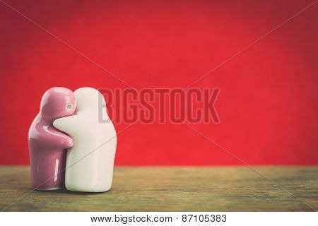 Two Ceramic Doll On Wood