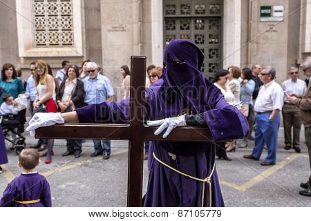 Penitent Posed Holding His Cross During Holy Week Procession, Spain