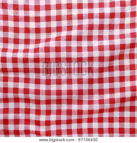 Red linen crumpled tablecloth background.