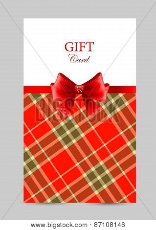 Greeting card with red bow, tartan