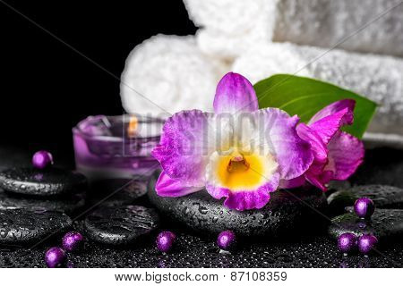 Beautiful Spa Background Of Orchid Dendrobium, Green Leaf, Candles, White Towels And Beads On Zen St