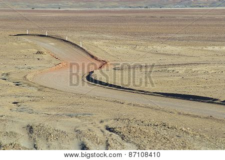 Winding desert road in the Australian Outback near Coober Pedy, Australia.