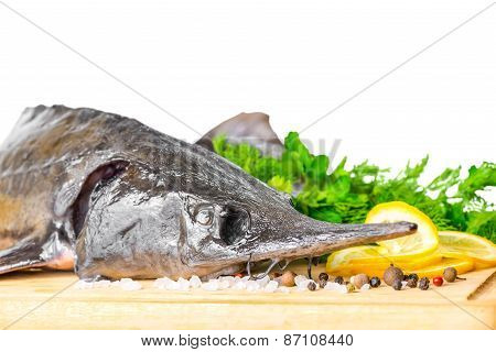 Fresh Raw Sturgeon Fish With Greens, Lemon, Different Peppers And Salt, Isolated On White Background