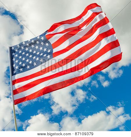 Usa Flag With Cumulus Clouds On Background