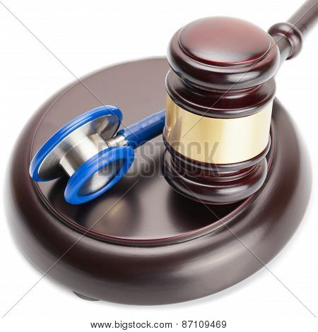 Judge Gavel And Stethoscope Near It