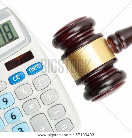 Judge's Gavel And Calculator. Studio Shot Over White