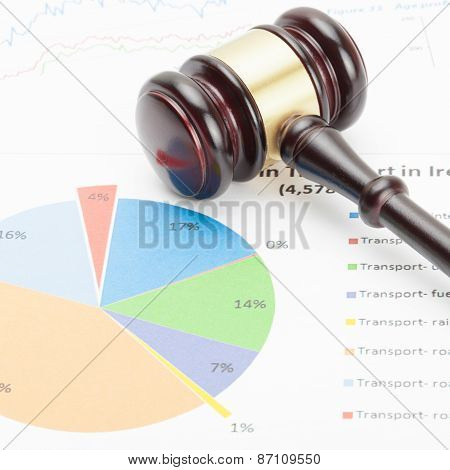 Wooden Judge's Gavel Over Colorful Diagram