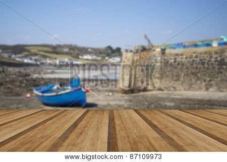 Harbour At Low Tide With Fishing Boats In Old Cornish Fishing Village With Wooden Planks Floor