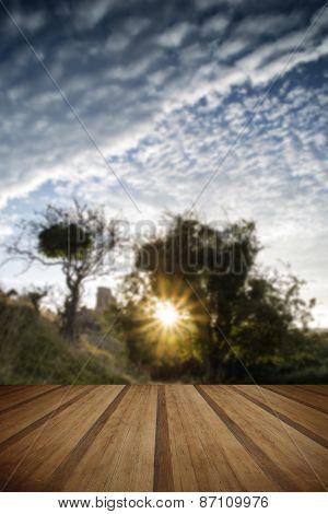 Castle Ruins Landscape At Sunrise With Inspirational Sunburst Behind Castle With Wooden Planks Floor