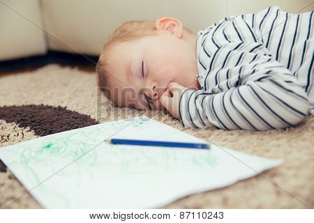 Little boy sleeping on the floor