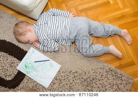 Little boy sleeping on the floor