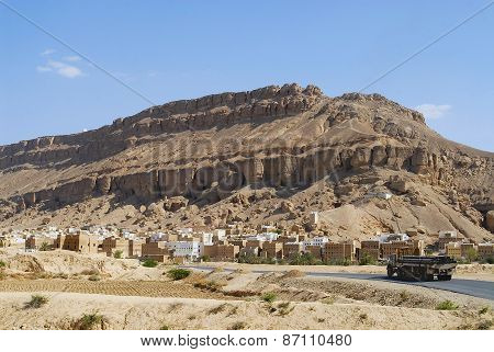 Truck passes by the road to the city of Shibam in Shibam, Yemen.