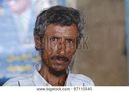 Portrait of unidentified senior man in Aden, Yemen.