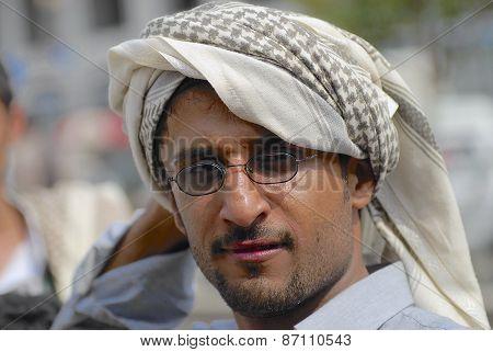 Portrait of unidentified man wearing traditional head scarf in Taizz, Yemen.