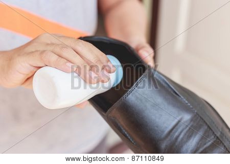 Hand Put Powder To A Shoe, Odor Stop
