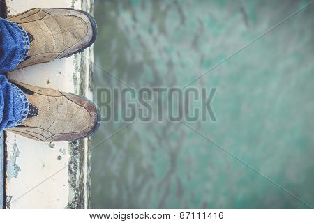 Feet Standing On Cement Edge