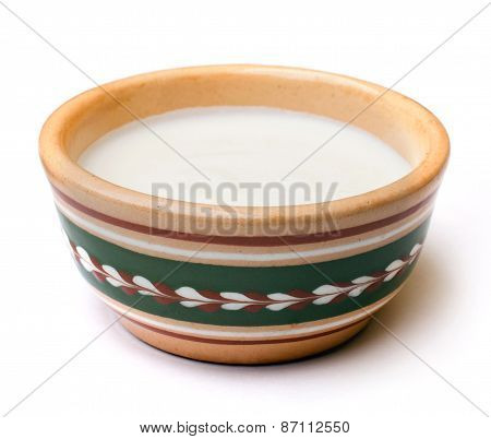 sour cream in a ceramic pot