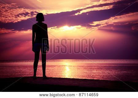 Silhouette of Young Woman Watching Sea Sunset