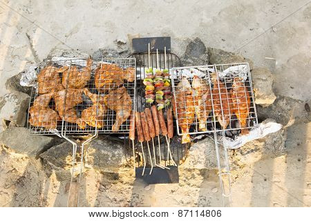 fish,sausage and chicken grilling