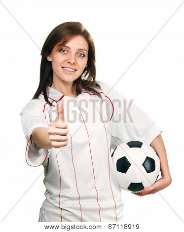 pretty girl with soccer ball shows thumb