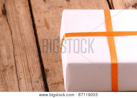 White Gift Box On Wooden Plate