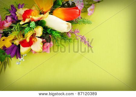floral arrangement on a yellow background