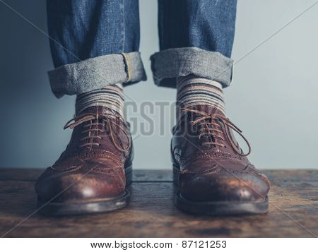 Feet Of A Man On Wooden Floor