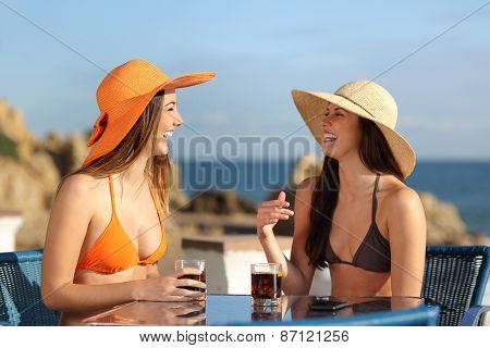 Two Friends Talking In An Hotel On Holidays