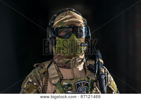 Airsoft strikeball player in uniform. Soldier full gear. Man with a gun is playing airsoft