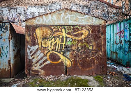 Old Rusted Garages With Grungy Graffiti Pattern