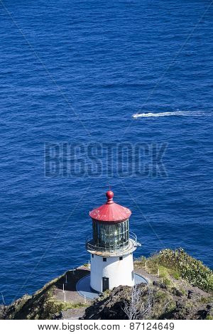 Makapuu Lighthouse On Ohau Island In Hawaii And Passing Boat