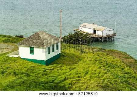 Boathouse On A Pier Next To Small House