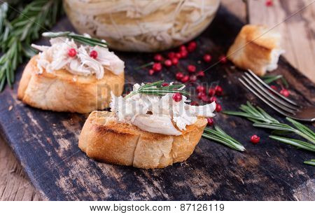 Toast Bread With Chicken Pate On Rustic Kitchen Board