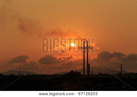 Smokestacks At Sunset Time