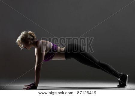 Beautiful Sporty Girl Doing Push-ups