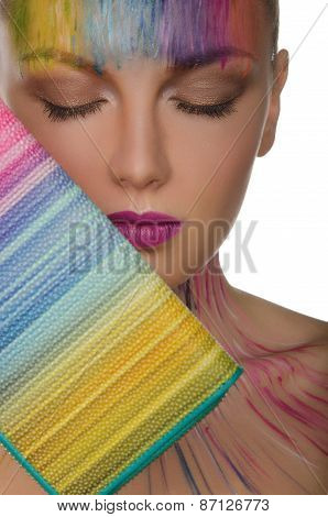 Beautiful Woman With Colorful Purse And Face Art