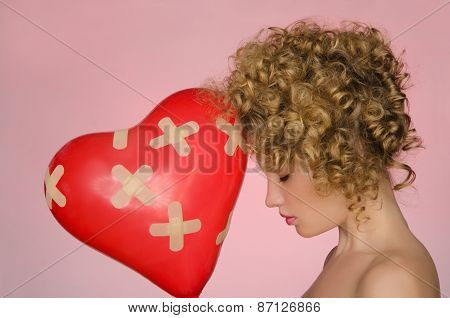 Hurt Woman With Ball In Shape Of Heart