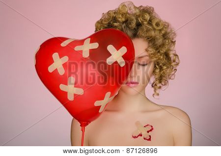 Woman With Patches On The Body And A Balloon