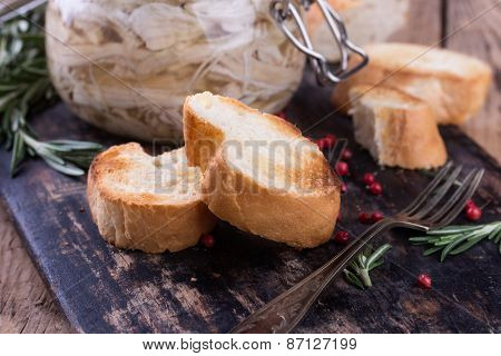 Chicken Pate In Glass Jar And Toast Bread On Rustic Kitchen Board