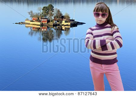 Teenage girl in pink wears sunglasses and sea island in background