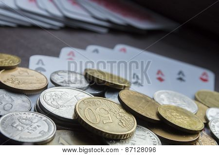 Coins and poker cards closeup