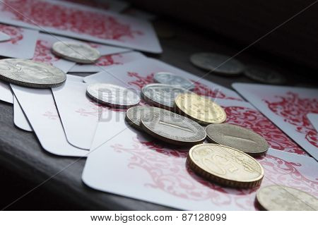 Various coins and poker cards